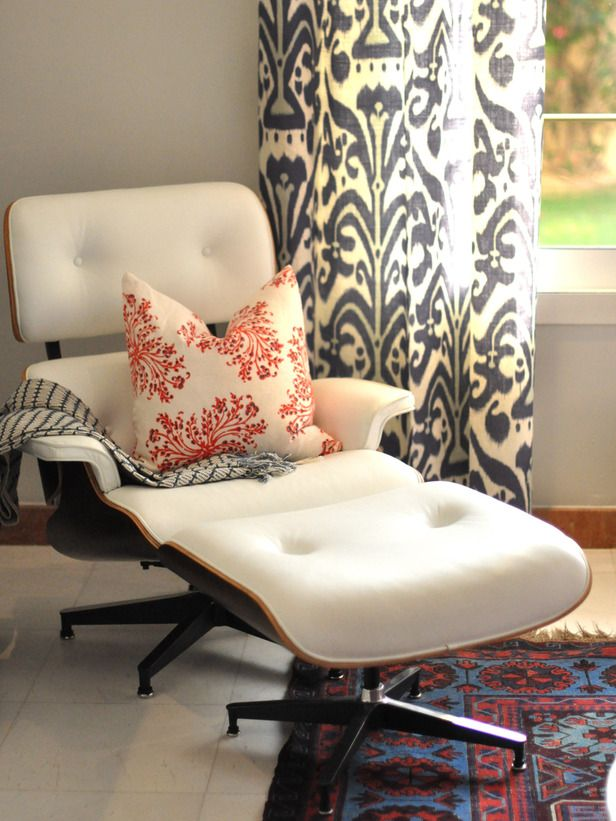 Mix Styles to Create a Focal Point:  By adding just a pop of a different design style, you can make a huge impact in a room. This modern Eames chair looks right at home with the mix of ethnic fabrics and an Oriental rug. Not only are two different design styles merged, but the room also has a focal point now. Photo courtesy of Caitlin Wilson.