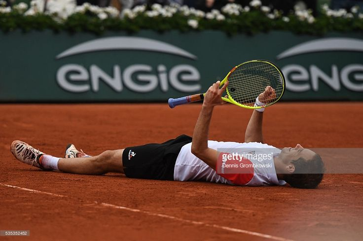 Richard Gasquet of France celebrates victory during the Men's Singles fourth round match against Kei Nishikori of Japan on day eight of the 2016 French Open at Roland Garros on May 29, 2016 in Paris, France.