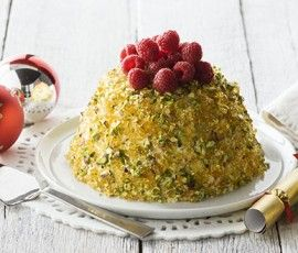White Choc Praline Ice Cream Pudding: What better way to finish a festive meal than with this decadent dessert? Filled with delicious ice cream and covered in pistachio praline it's one recipe that's sure to impress your Christmas guests!. http://www.bakers-corner.com.auhttps://www.bakers-corner.com.au/recipes/puddings/white-choc-praline-ice-cream-pudding/