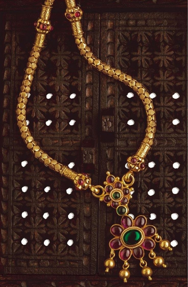 Gold necklace with ruby and emerald pendant