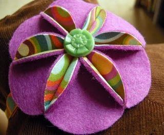 felt flower. Can see this in fabric.