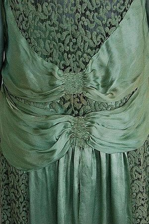Jeanne Paquin labelled green lace and satin dress, Summer 1927    Large woven satin label, dated and numbered 40563, with diagonal satin bands converging at the front with two floating panels, interal satin waist slip, bust 92cm, 36in - Estimate £500 - £700  Kerry Taylor Auctions - London - June 17, 2009