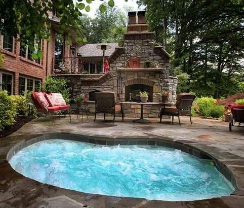 Hot tub next to a fire place
