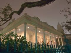 New Orleans garden district houses - Magnolia hotel (A. Harris house, 1857-58) at a corner of 2127 Prytania Street and Jackson Avenue in Garden District at night. New Orleans, Louisiana, February 22, 2006
