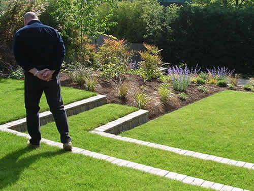14 best ideas for front lawn images on pinterest for Gartenidee hanglage
