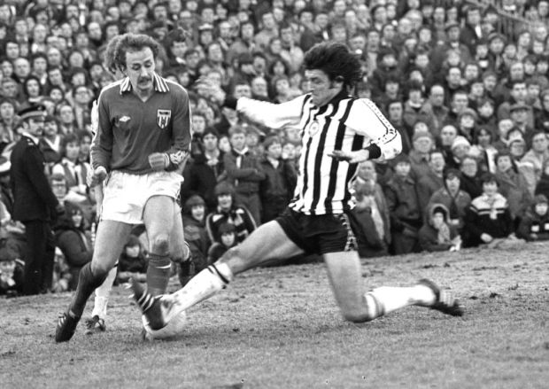 February 1979: Newcastle United 1 Sunderland 4: Mick Henderson storms forward in another Sunderland attack only to be halted by John Bird.