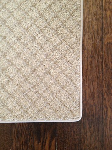 DIY How to Turn a Carpet Remnant into an Area Rug -- cut to desired dimensions, & use Insta-Bind to give the edges a nice finish