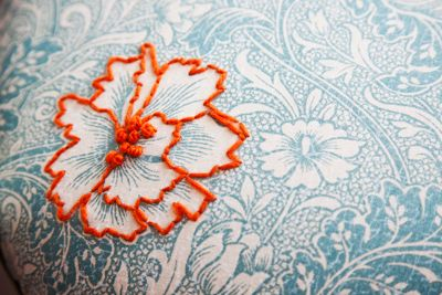 One embroidered motif on a printed fabric. Very effective.