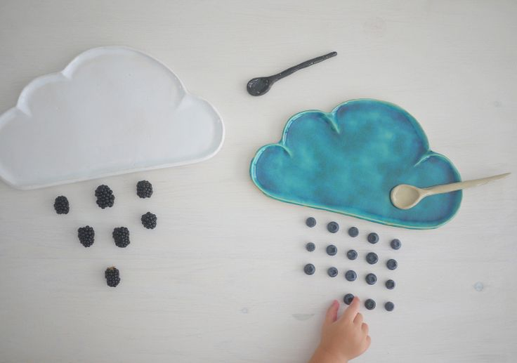 white and blue ceramic cloud plates designed by projectorium. can be used both by kids and adults. Ceramic spoons and ceramic raindrops can be part of the tableware.