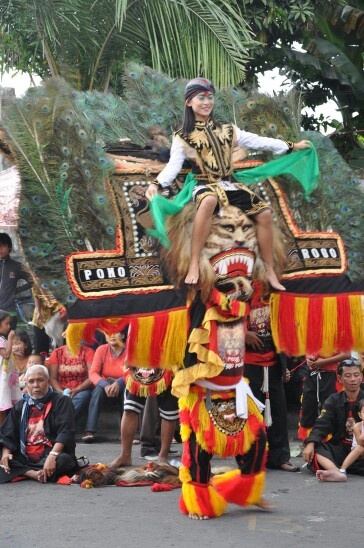 Reog Ponorogo ....the mask weighed more than 30 kg....not including the girl ....all carried by head.. Dancing around....at Surabaya, Indonesia