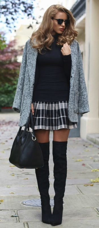 Nada Adelle wears patent over the knee boots with a cute tartan mini skirt and a grey boyfriend coat. Coat: Glamorous, Turtle Neck: Missguided, Over Knee Boots: Simmi Shoes.