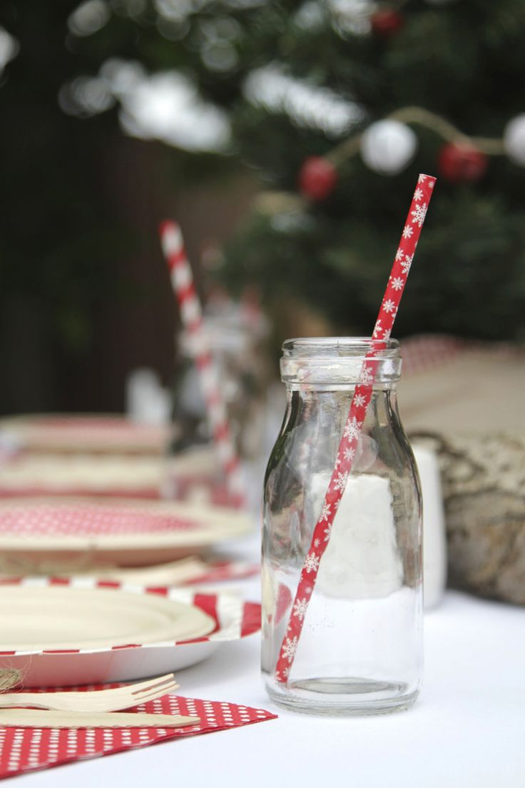 Milk bottles and Christmas straws, love this little combination for a simple yet festive table setting | The Paper Lantern |
