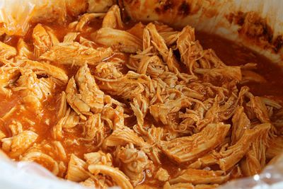 3 Ingredient Crockpot Buffalo Chicken- Easy and LOW carb treat to help you make it through football season and still wear those skinny pants... ;)