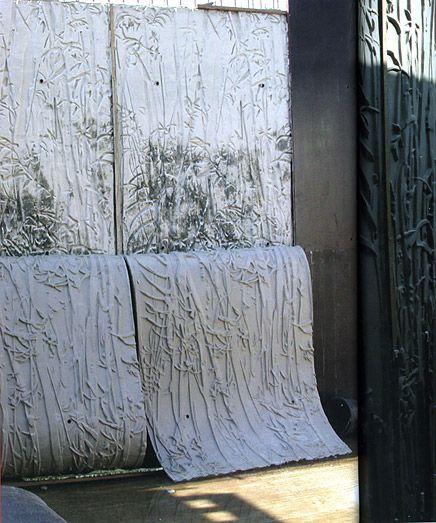 Making of the glazed, black concrete panels.