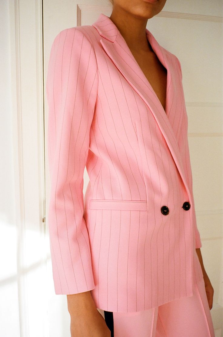 Let this oversized pink blazer speak for itself. An absolute outfit maker, this pinstripe jacket will ...