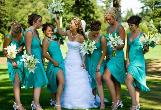 bright blue bridesmaid dresses with white bouquets.  Classy.