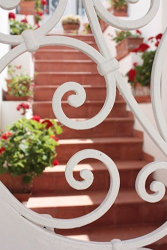 railing in front of terracotta stairs