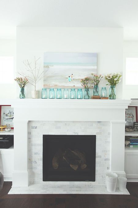 marble subway tile on fireplace