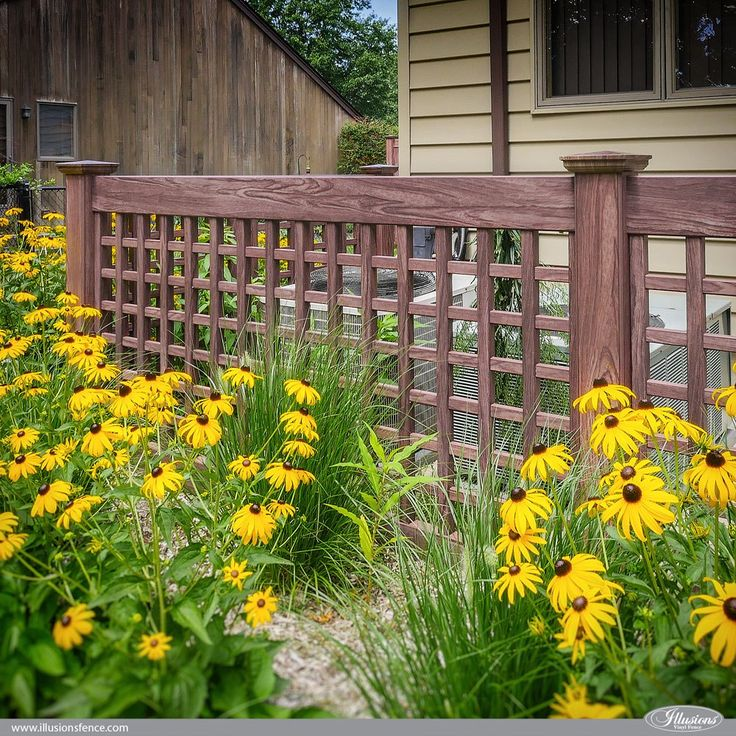 Looking for an enclosure to hide your air conditioner or trash cans? How about a PVC vinyl wood grain lattice fence from @illusionsfence? Shown here is the beautiful VSQL48 Old English Lattice panels in Grand Illusions Vinyl WoodBond Walnut. #landscapingideas #homeideas #fenceideas #backyardideas #homedecor