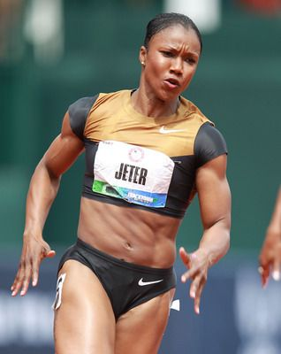 Carmelita Jeter she is running so fast her muscles can't even keep up! Check out that stomach!!! Sheesh