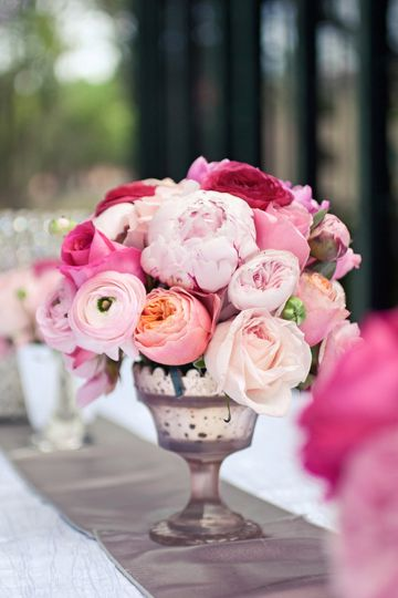 gorgeous pink ranunculus, peony, and rose centerpiece (photo by Brooke Images)