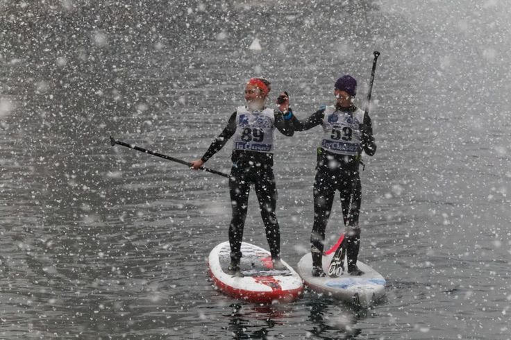 Snow covered SUPers merrily paddling down the River Seine for the sup nautic crossing in Paris #exploreyourworld