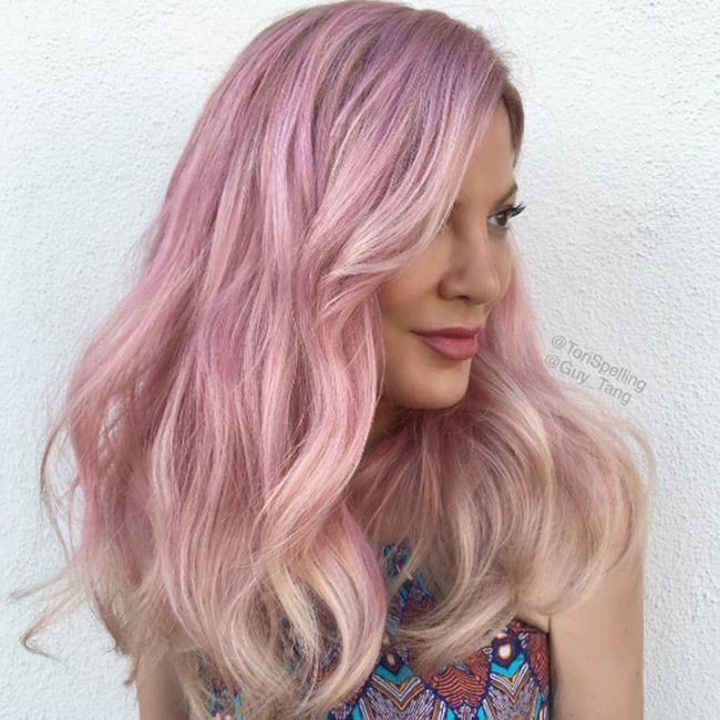 Tori Spelling went for a bold new hair color just in time for Independence Day. The 43-year-old took to Instagram to reveal that she has ditched her trademark blonde locks in favor of eye-catching pink hues.