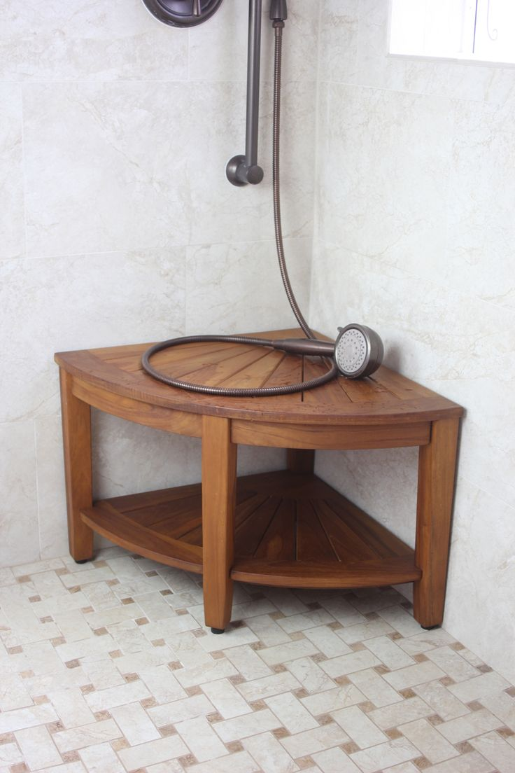 "Aqua Teak - The Original 22"" Kai Corner Teak Shower Bench with Shelf, $199.95 (http://www.aquateak.com/corner-shower-benches-stools/the-original-22-kai-corner-teak-shower-bench-with-shelf/)"