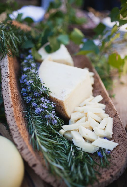 beautiful presentation with herbs in wooden trough | wedding reception cheese table