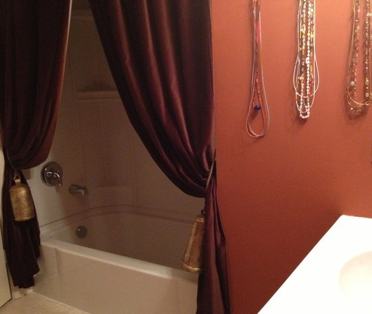 love the burnt orange for a bathroom... those curtains... mmm. stage for shower singing!