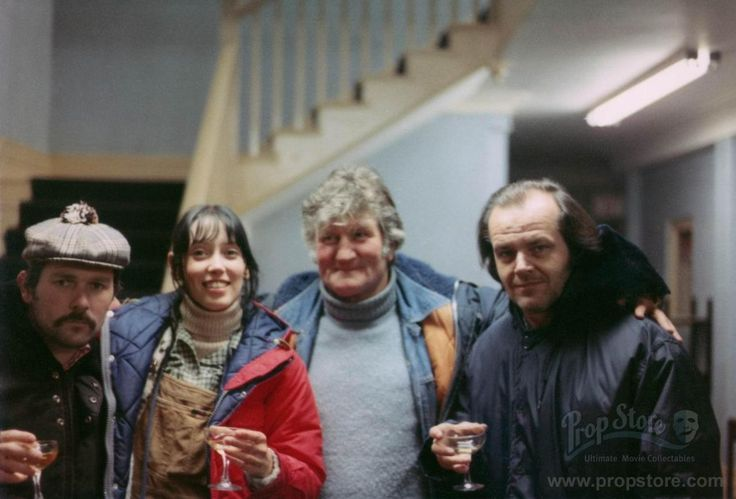 Never-before-published photo of actors Shelley Duvall and Jack Nicholson sharing a toast with crew members on the Staff Wing set of The Shin...