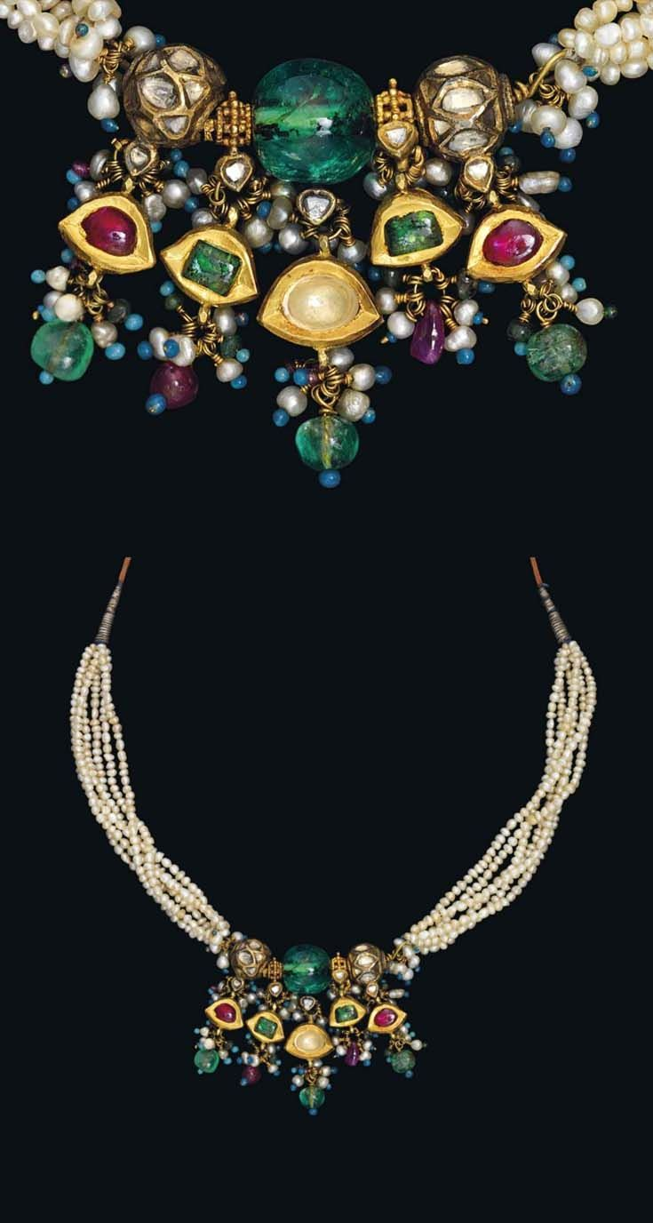 North India | Necklace; central large emerald, flanked by diamond set gold beads, further emeralds and rubies, pearls, gemstones, enamelled beads strung on silk and metal thread cord.  | ca. 19th century | Est. 4'000 - 6'000£ ~ Oct '15