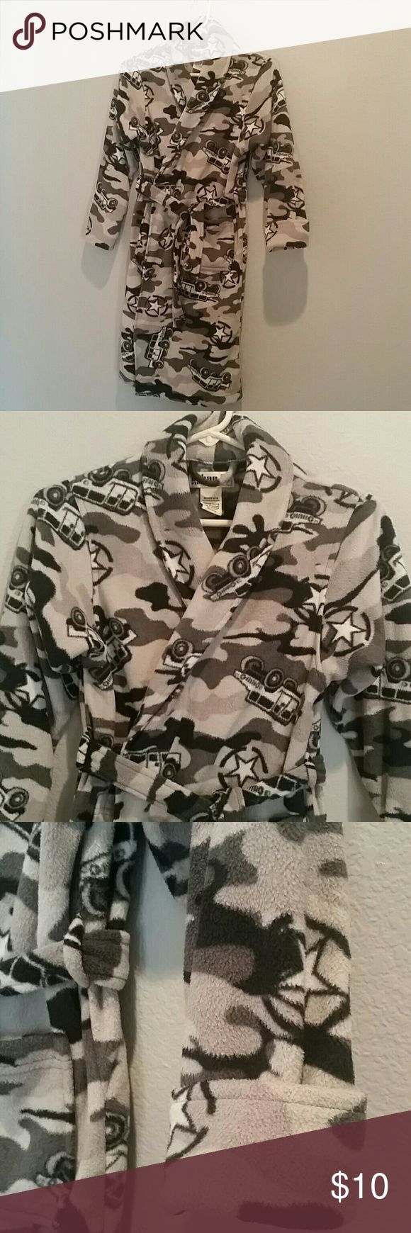 """Boys Camo Print Bathrobe from Urban Pipeline Boys bathrobe in like new condition. Warm and fleecey with a tie at the waist and front pockets. Sleeves can be cuffed or worn long. 100% fire retardant fleece. Worn  just a few times. Sleeves measure 21"""" uncuffed and 34"""" shoulder to hem. Size 8/10. All children's bundles 20% off. Urban Pipeline Pajamas Robes"""