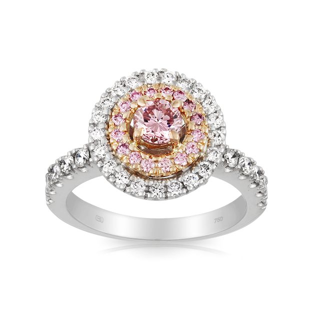 Crafted in 18 carat white gold and featuring an impressive .34ct vibrant Pink Diamond centre enhanced by a double halo of both pink and white Diamonds, this ring is absolutely breath taking.