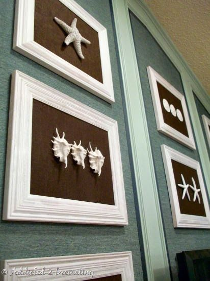 From Addicted to Decorating, fun white seashells in white painted frames