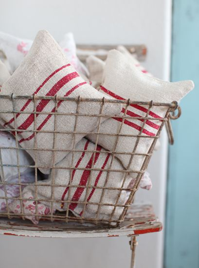 Lavender pillows made from antique European grain sacks. Umm, I love lavender.