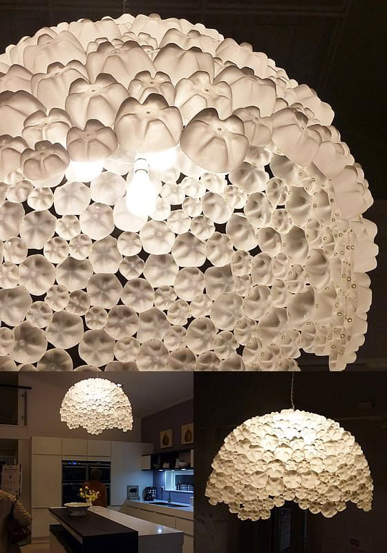 This amazing lamp was made by Sarah Turner when she was asked by the Ideal Home Show to create a large ceiling pendant from waste plastic bottles. Sarah re