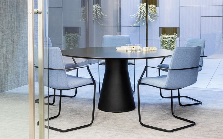 Flex cantilever armchair and Reverse Conference table from Andreu World