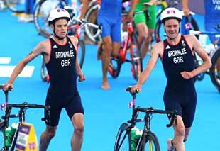 Image: (From left) Jonathan & Alistair Brownlee of Great Britain during the triathlon on Tuesday (© Paul Gilham/Getty Images)