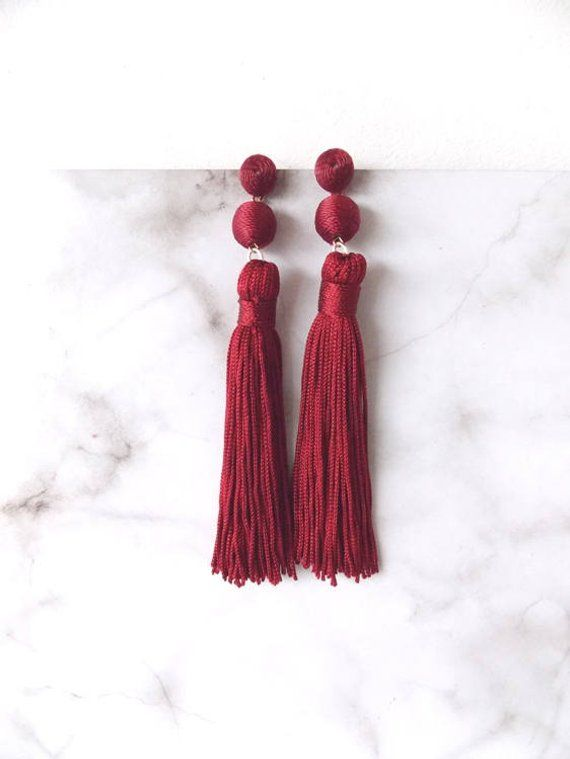 720dc0001 Burgundy/deep red tassel statement earrings from Olivia Divine. Thread ball  style beads with long tassel drop. Pierced. Lightweight. Length 13.5cm  approx