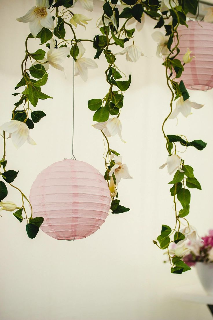 blush pink paper lanterns and floral guirlandes by Eindeloos Weddings & Events. Photo: Fotozee
