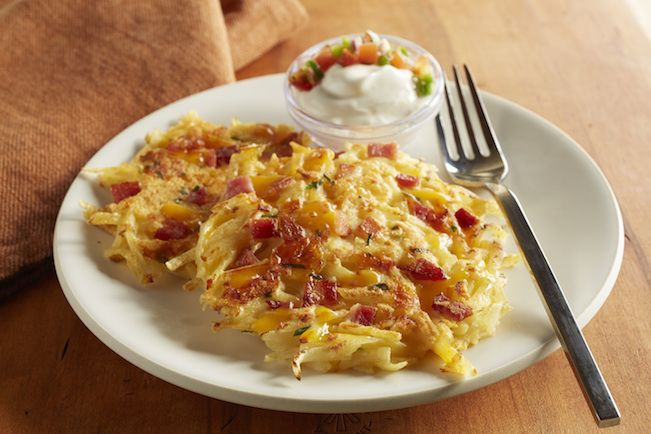 The Loaded Hashbrown Pancakes are a great mix of Hungry Jack® Hashbrowns, bacon, Cheddar cheese, chives, and eggs, with a sour cream and salsa topping. A super simple breakfast option for the whole family!