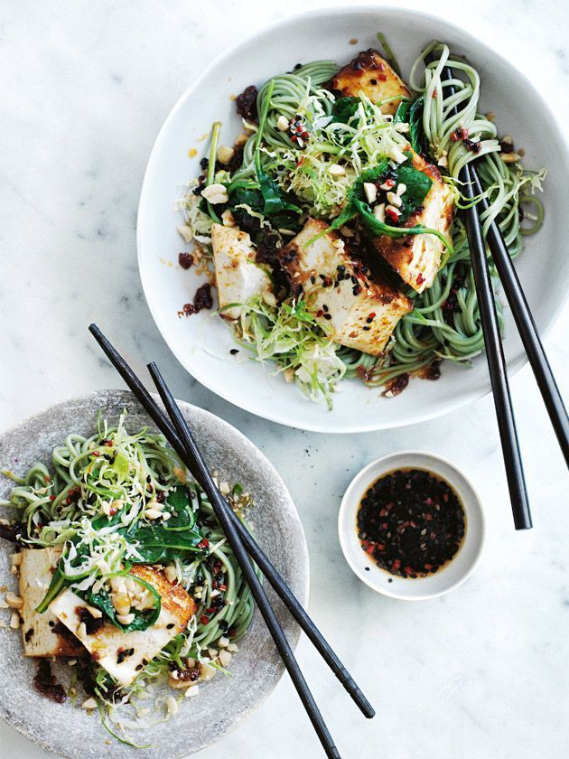 {Baked chilli tofu and kale noodles with black sesame dressing.}