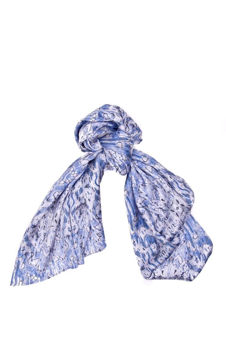 Dapper Deauville - Long Scarf  Combining the soft undertones of blue, this piece achieves a high level of grace and sophistication. The gentle shaping created from the waters provides a brilliant mosaic piece capable of classing up even the most mundane of looks.