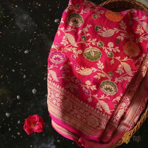 Rani Pink-Red Pure Katan Silk Banarasi Handloom Saree - This is a regal Banarasi saree with a classic floral jangla pattern, crafted in the finest weave style. With its superbly crafted Meenakari and zari work, this will certainly become your signature drape!
