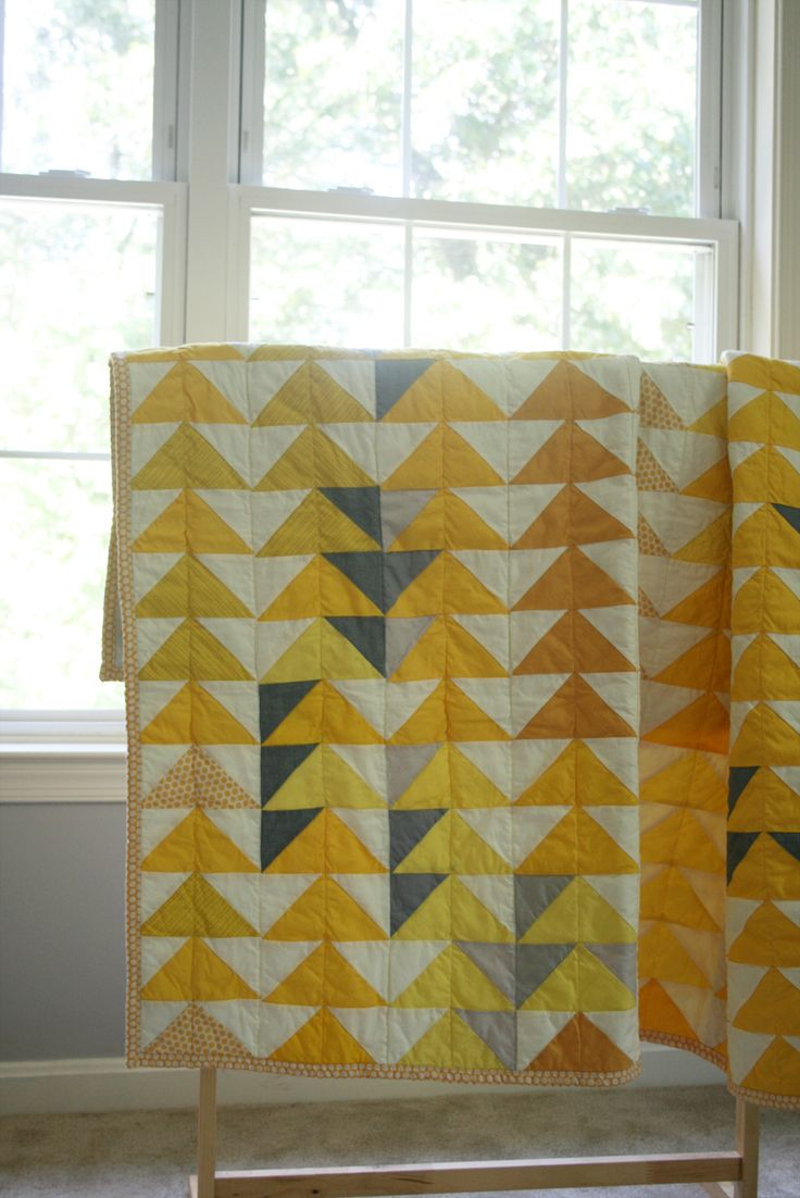 """This soft and lightweight quilt can be used as a lap quilt, a blanket for little children or a wall hanging piece to brighten any contemparay space. The quilt features traditional flying geese pattern that has been cherished by many quilters and quilt lovers for a long time in combination with simple contemporary color palette. The quilt measures approx. 46""""x46"""" and made with 100% cotton fabric and cotton batting."""