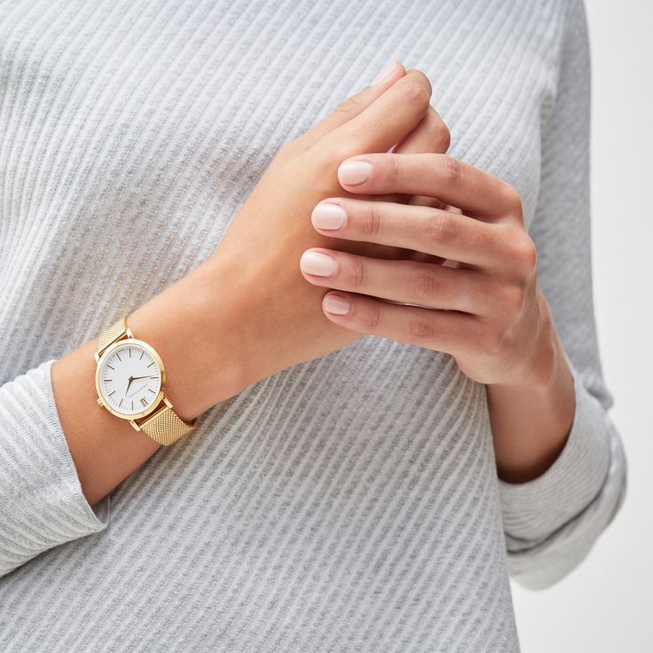 This small elegant watch by Larsson & Jennings features a fine mesh strap and classic gold-plating finish.   #goldwatches #womenswatches #design