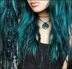 aqua blue dreads. I think i like the mix of dreds and natural hair
