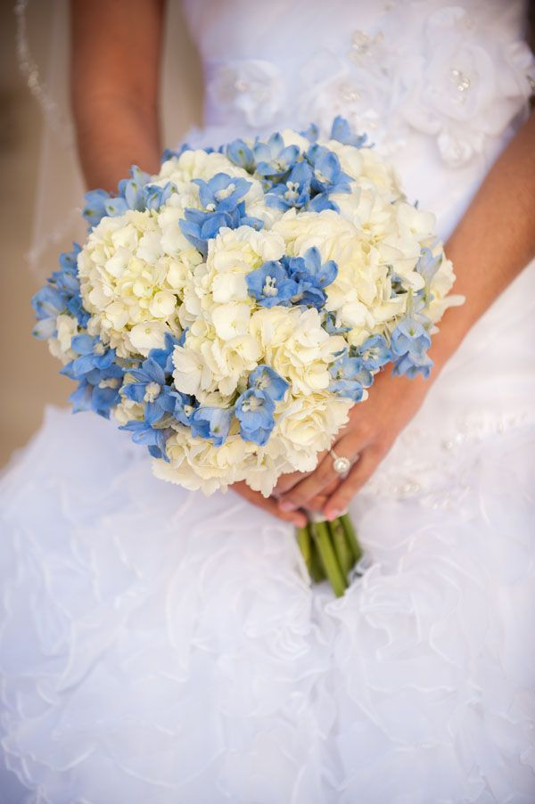 A beautiful white and blue bridal bouquet. We love it!