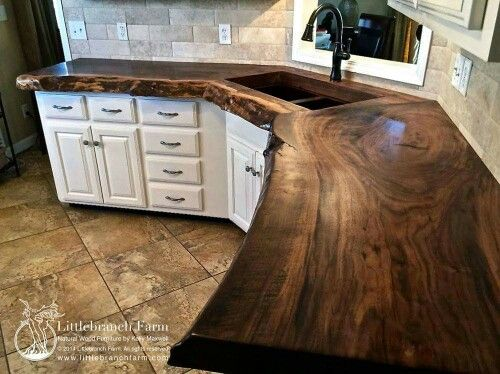 Claro walnut slab wood countertop. http://littlebranchfarm.com/natural-wood-countertops/